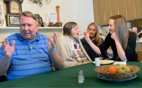 Al Hartmann  |  The Salt Lake Tribune Merrill Cook, former congressman and perennial candidate, is now a full-time caregiver for his wife, Camille who suffers from Alzheimer's disease.  The couples daughters Alison and Michelle who are visiting from out of town help feed breakfast to their mother Camille.