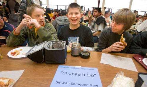"Paul Fraughton  |  The Salt Lake Tribune Chase Manning, center, sits at a table in the lunch room of Midvale Middle School with students he normally doesn't sit with, namley Davis Mendel, left, and John Guldner. ""Change it Up"" encouraged students to associate with different kids by sitting at different tables in the lunch room."