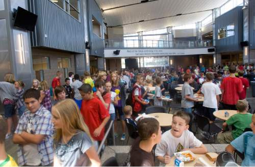 Al Hartmann  |  The Salt Lake Tribune Students file into the spacious common area of the lunch room in the new Centennial Junior High School in Kaysville.