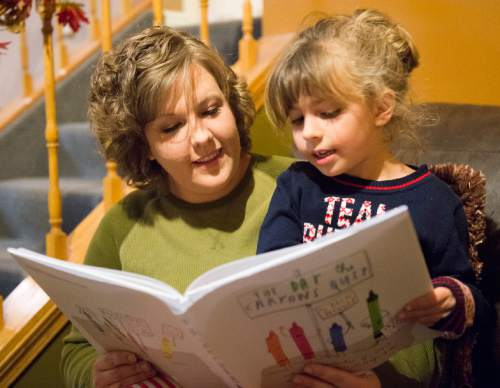 Rick Egan  |  The Salt Lake Tribune Alicia Hobson reads with her a 6-year-old daughter Azlyn, in her home in Lehi in November.