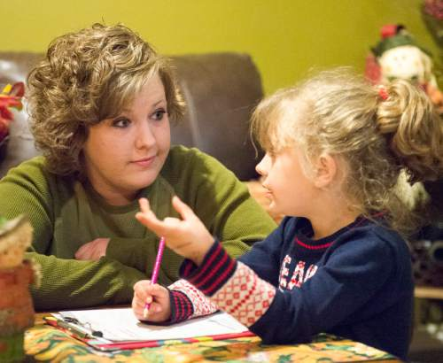 Rick Egan  |  The Salt Lake Tribune   Alicia Hobson helps her a 6-year-old daughter Azlyn with her homework, in her home in Lehi, Tuesday, November 11, 2014