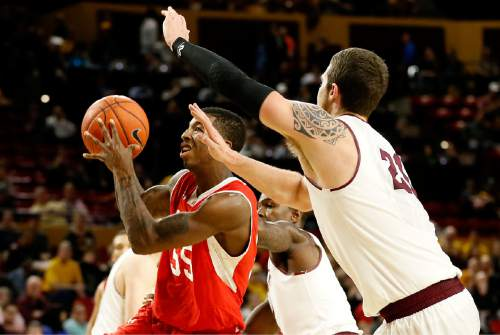 Utah's Delon Wright (55) drives past Arizona State's Eric Jacobsen, right, during the first half of an NCAA college basketball game, Thursday, Jan. 15, 2015, in Tempe, Ariz. (AP Photo/Matt York)