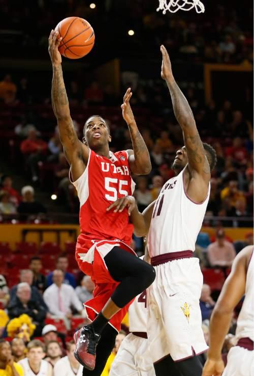 Utah's Delon Wright (55) drives past Arizona State' Savon Goodman during the first half of an NCAA college basketball game, Thursday, Jan. 15, 2015, in Tempe, Ariz. (AP Photo/Matt York)