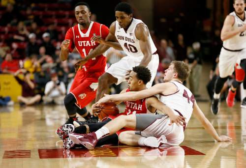 Utah's Brandon Taylor, seated left, and Arizona State's Kodi Justice (44) battle for the ball during the second half of an NCAA college basketball game, Thursday, Jan. 15, 2015, in Tempe, Ariz. (AP Photo/Matt York)