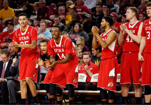 The Utah bench cheers during the second half of an NCAA college basketball game against Arizona State, Thursday, Jan. 15, 2015, in Tempe, Ariz. (AP Photo/Matt York)
