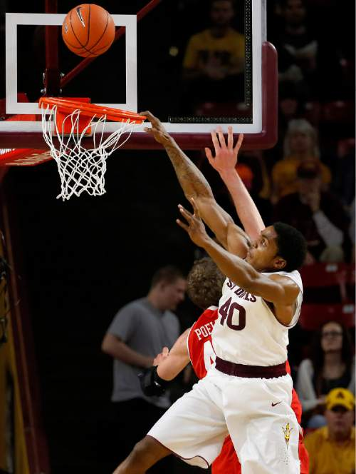 Arizona State's Shaquielle McKissic (40) misses a dunk after being partially blocked by Utah's Jakob Poeltl, of Austria, during the second half of an NCAA college basketball game, Thursday, Jan. 15, 2015, in Tempe, Ariz. (AP Photo/Matt York)