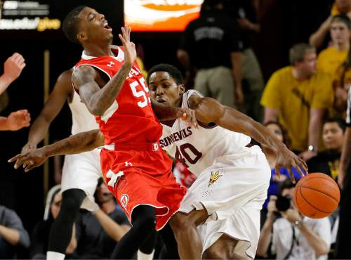 Arizona State's Shaquielle McKissic (40) collides with Utah's Delon Wright during the first half of an NCAA college basketball game, Thursday, Jan. 15, 2015, in Tempe, Ariz. (AP Photo/Matt York)
