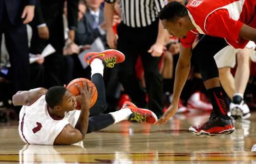 Arizona State's Roosevelt Scott (1) looks to pass as he slides on the floor as Utah's Dakarai Tucker pursues during the first half of an NCAA college basketball game, Thursday, Jan. 15, 2015, in Tempe, Ariz. (AP Photo/Matt York)