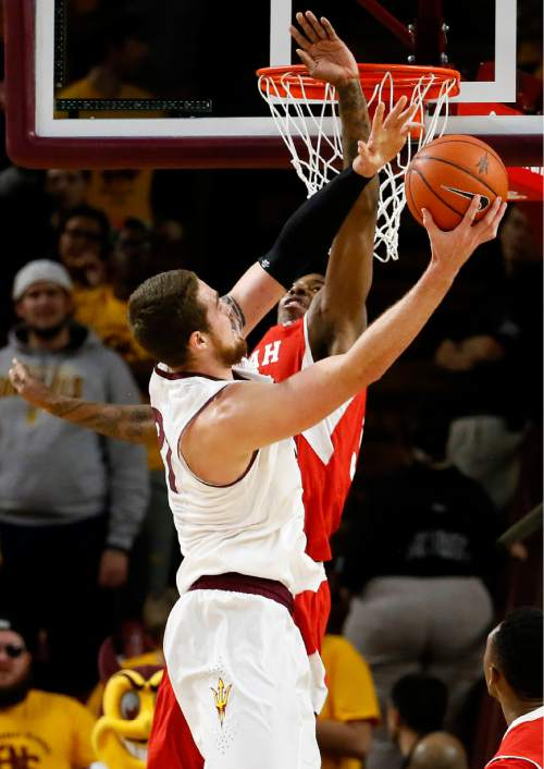 Utah's Delon Wright, rear, cannot stop a shot by Arizona State' Eric Jacobsen during the first half of an NCAA college basketball game, Thursday, Jan. 15, 2015, in Tempe, Ariz. (AP Photo/Matt York)