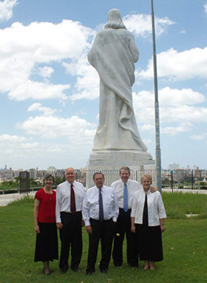 Courtesy  |  Intellectual Reserve  Elder Jeffrey R. Holland, center, with Elder Donald L. Hallstrom of the Presidency of the Seventy, right, Sister Diane Hallstrom; Elder Wilford W. Andersen of the Seventy and president of the Caribbean Area, left, and Sister Kathleen Andersen, in Havana, Cuba, on June 15.