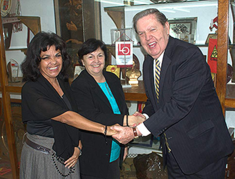 Courtesy  |  Intellectual Reserve LDS apostle Jeffrey R. Holland greets Caridad Diego, center, and Sonia Garcia, both with the Cuban Office of Religious Affairs, in Havana, Cuba. He says the church expects to see have about 100,000 full-time missionaries by 2019.
