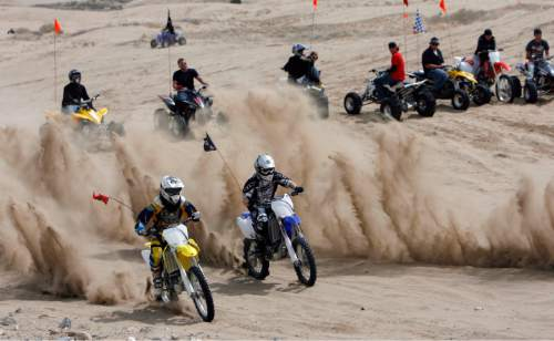 Francisco Kjolseth  |  Tribune file photo  Conquering Sand Mountain, motor enthusiasts ride Utah's Little Sahara on April 10, 2009.