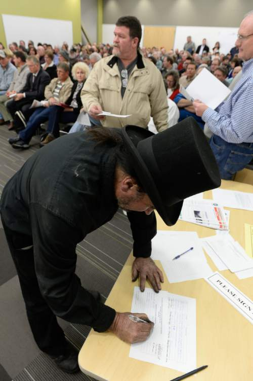 Francisco Kjolseth  |  The Salt Lake Tribune  Jon Perry with AAA London Chimney Sweep signs up to speak as the State holds a packed public hearing on Gov. Gary Herbert's proposed wintertime wood burn ban in Salt Lake City. The hearing held at the Salt Lake City Department of Environmental Quality is one of 7 scheduled across northern Utah.