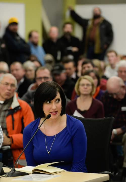 Francisco Kjolseth  |  The Salt Lake Tribune  Tina Escobar with Utah Mom's for Clean Air speaks in support of the wood burning ban in a room primarily filled with people in opposition as the State holds a packed public hearing on Gov. Gary Herbert's proposed wintertime wood burn ban in Salt Lake City. The hearing held at the Salt Lake City Department of Environmental Quality is one of 7 scheduled across northern Utah.