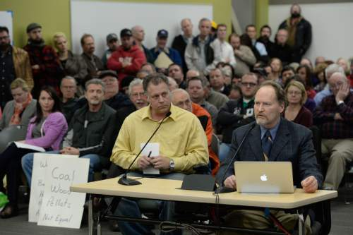 Francisco Kjolseth  |  The Salt Lake Tribune  Dr. Brian Moench, right, President of Utah Physicians for a Healthy Environment speaks in support of the wood burning ban as the State holds a packed public hearing on Gov. Gary Herbert's proposed wintertime wood burn ban in Salt Lake City. The hearing held at the Salt Lake City Department of Environmental Quality is one of 7 scheduled across northern Utah.