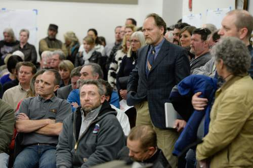 Francisco Kjolseth  |  The Salt Lake Tribune  Dr. Brian Moench, center right, President of Utah Physicians for a Healthy Environment waits his turn to speak as the State holds a packed public hearing on Gov. Gary Herbert's proposed wintertime wood burn ban in Salt Lake City. The hearing held at the Salt Lake City Department of Environmental Quality is one of 7 scheduled across northern Utah.