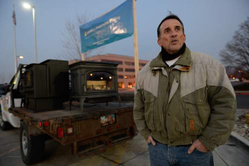 Francisco Kjolseth  |  The Salt Lake Tribune  Randy Toupin with Utahns For Responsible Burning keeps his wood burning stoves off because of the red air day but had them fired up the day before in Tooele. Toupin was set up outside as the State held a packed public hearing on Gov. Gary Herbert's proposed wintertime wood burn ban in Salt Lake City. The hearing held at the Salt Lake City Department of Environmental Quality is one of 7 scheduled across northern Utah.