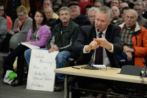 Francisco Kjolseth  |  The Salt Lake Tribune  Craig Loftgren expresses his opposition to being able to burn wood as the State holds a packed public hearing on Gov. Gary Herbert's proposed wintertime wood burn ban in Salt Lake City. The hearing held at the Salt Lake City Department of Environmental Quality is one of 7 scheduled across northern Utah.