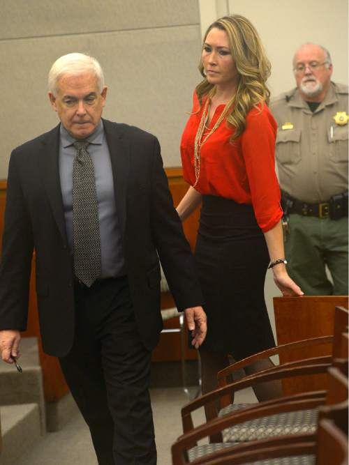 Leah Hogsten  |  The Salt Lake Tribune Brianne Altice heads into the courtroom with her attorney Ed Brass for a preliminary hearing in Judge John R. Morris' 2nd District Court, Thursday January 15, 2015.  Altice, was taken into custody and is headed to trial with 10 felony counts for alleged sexual relationships with three teens: five counts of first-degree felony rape, two counts of first-degree felony forcible sodomy and three counts of second-degree felony forcible sexual abuse in connection with allegedly having sex with the three male students.