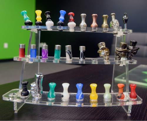 Al Hartmann  |  The Salt Lake Tribune Custom mouth pieces for e-cigarettes.  The devices continue to gain in popularity as the state of Utah and local health departments clamp down, trying to keep them away from children and teenagers and ensure the labels show the true content of nicotine. The governor wants to tax e-cigarettes, and Utah lawmakers are likely to take up legislation again.