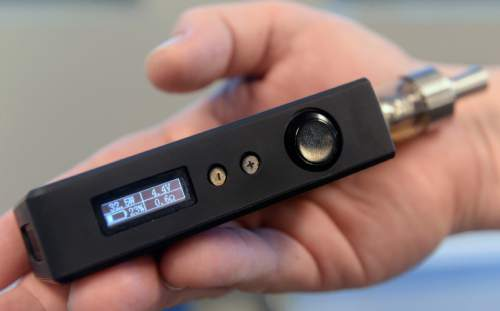 Al Hartmann  |  The Salt Lake Tribune Third generation e-cigarette has LED screen to display wattage for changing vapor output and rechargeable battery level.  The devices continue to gain in popularity as the state of Utah and local health departments clamp down, trying to keep them away from children and teenagers and ensure the labels show the true content of nicotine. The governor wants to tax e-cigarettes, and Utah lawmakers are likely to take up legislation again.