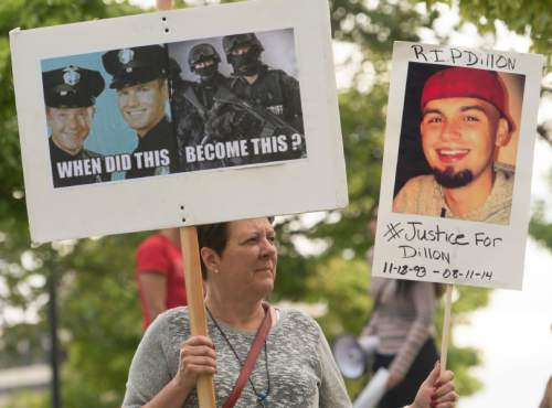 Rick Egan  |  Tribune file photo Protesters march in downtown Salt Lake City in August in solidarity with Mike Brown, Dillon Taylor, Danielle Willard and other unarmed people shot and killed by officers.