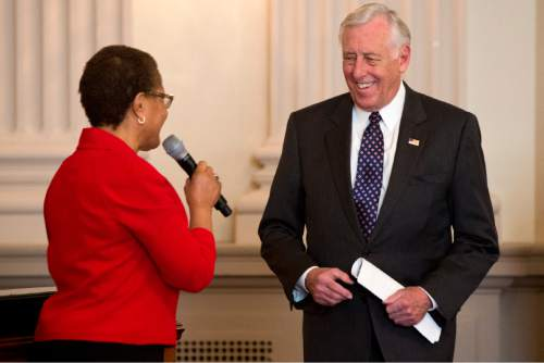 Rep. Karen Bass, D-Calif., left, introduces House Minority Whip Steny Hoyer of Md., during a discussion a discussion: The Ebola Crisis in West Africa: An Update on Progress, Challenges and the Road to Recovery on Ebola in West Africa, Tuesday, Jan. 13, 2015, on Capitol Hill in Washington. (AP Photo/Jacquelyn Martin)