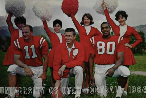 Courtesy  |  Utah Athletics  From left to right, captain Ernest ÏPokeyÓ Allen, head coach Ray Nagel and alternate captain Roy Jefferson grace the 1964 Utah football media guide cover, along with Ute Songleaders Diane Allred, Carolann Nakamura, Leslie James and Monetta Bostrum.