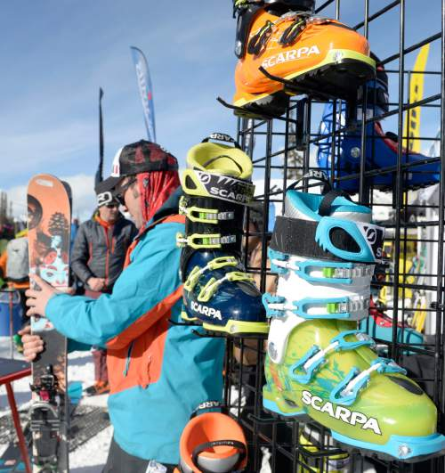Al Hartmann  |  The Salt Lake Tribune Outdoorsmen for the Winter Market Outdoor Retailers check out equipment display booth of Scarpa ski boots at Solitude Mountain Resort for the All Mountain Demo on Tuesday. The demo day gives retailers the opportunity to test gear in the environment it was made for to make informed buying decisions.