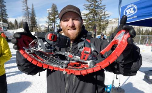 Al Hartmann  |  The Salt Lake Tribune Mike Sleeper, a representative for TSL Snowshoes out of Williston, Vt., shows the flexibility of a pair of the company's snowshoes at the Winter Market Outdoor Retailers at Solitude Mountain Resort for the All Mountain Demo Tuesday Jan. 20, 2015. They are very light and made of polypropylene and carbon fiber. The demo day gives retailers the opportunity to test gear in the environment it was made for to make informed buying decisions.