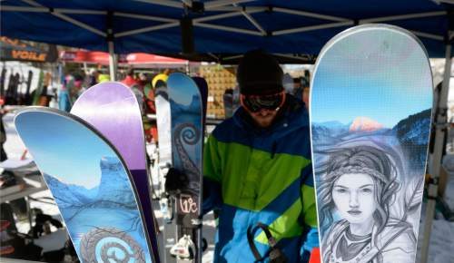 Al Hartmann  |  The Salt Lake Tribune An outdoorsman at the Winter Market Outdoor Retailers checks out intricate artwork on a pair of Icelantic skis at Solitude Mountain Resort for the All Mountain Demo Tuesday Jan. 20, 2015. The demo day gives retailers the opportunity to test gear in the environment it was made for to make informed buying decisions.