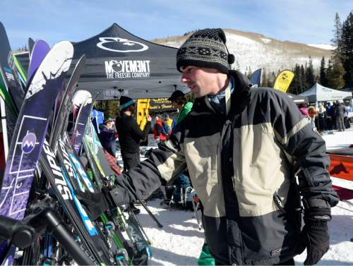 "Al Hartmann  |  The Salt Lake Tribune Alan Perryman, owner of AlpineExtreme.Co out of Boseman, Mont., an outdoor company that caters to backcountry gear for ""alpine addicts,"" checks out a pair of skis from the Movement Freeski Company at the Winter Market Outdoor Retailers at Solitude Mountain Resort for the All Mountain Demo Tuesday Jan. 20, 2015. The demo day gives retailers the opportunity to test gear in the environment it was made for to make informed buying decisions."
