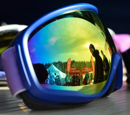 Al Hartmann  |  The Salt Lake Tribune The Winter Market Outdoor Retailers at Solitude Mountain Resort for the All Mountain Demo Tuesday Jan. 20, 2015, is reflected in a pair of Zeal Optics ski goggles. The company is out of Boulder, Colo. The demo day gives retailers the opportunity to test gear in the environment it was made for to make informed buying decisions.