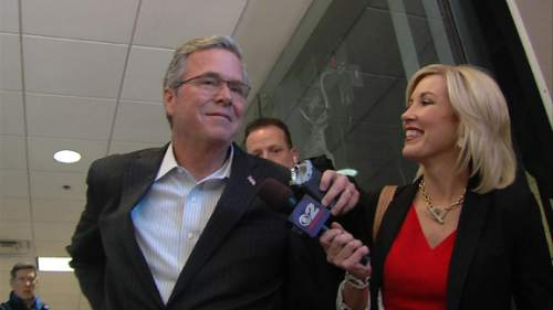 Courtesy  |  KUTV  Jeb Bush arrives in Salt Lake City on his way to meet Mitt Romney, Thursday, Jan. 22, 2015.