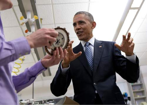President Barack Obama speaks with Sarah Haight with Rekluse Clutch Revolution as he tours the new Product Development Lab in Boise State University's Micron Engineering Center, Wednesday, Jan. 21, 2015, in Boise , Idaho, before speaking about the themes in his State of the Union address. (AP Photo/Carolyn Kaster)