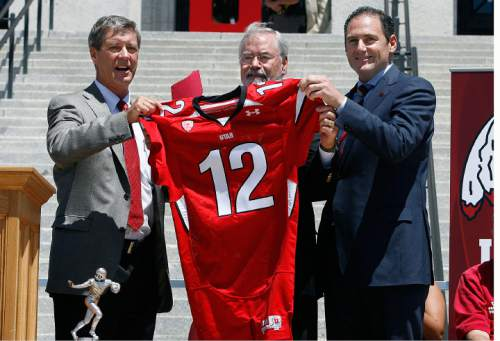 Scott Sommerdorf  |  The Salt Lake Tribune Utah athletic director Chris Hill, left, Utah interim president Lorris Betz, and Pac-12 commissioner Larry Scott hold up a football jersey commemorating the day as the University of Utah officially became a member of the Pac-12 conference on July 1.