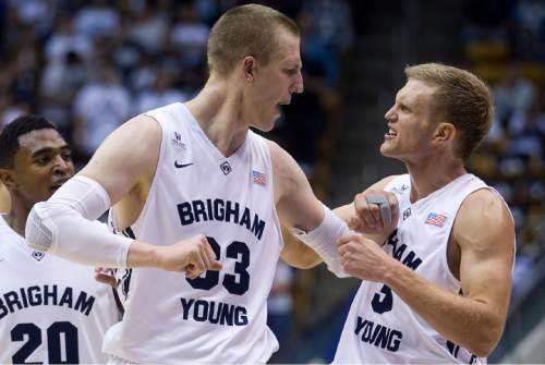 BYU's Tyler Haws, right, celebrates after Nate Austin, left, drew a foul in the final minutes against Long Beach State during an NCAA college basketball game Friday, Nov. 14, 2014, in Provo, Utah. (AP Photo/Daily Herald, Grant Hindsley)