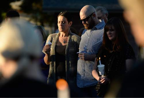 Francisco Kjolseth  |  The Salt Lake Tribune Amanda and Ryeley Muir attend a vigil for their friends the Strack family at Pioneer Park in Provo after the family of five were mysteriously found dead in their Springville home last Saturday. A Springville Police news release identified them Sunday as Benjamin Strack, 37, his wife, Kristi Strack, 36, two of their sons -- Benson Strack, 14, and Zion Strack, 11 -- and their daughter Emery Strack, 12. Preliminary autopsies ruled out any sort of violent assault, according to the release.
