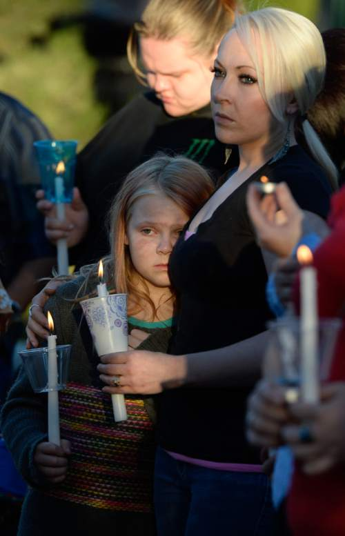 Francisco Kjolseth  |  The Salt Lake Tribune Shantay Healey comforts her daughter Annika Younkin, 10, as they attend a vigil for their friends the Strack family at Pioneer Park in Provo after the family of five were mysteriously found dead in their Springville home last Saturday.