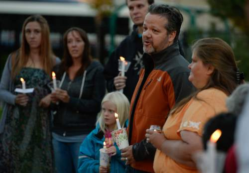 Francisco Kjolseth  |  The Salt Lake Tribune Issac Strack, brother of Benjamin Strack, who was found dead alongside his wife and three children last Saturday at their home in Springville, thanks friends, family and many who never knew the Strack family but have shown love and support during a difficult time, as they came together for a candlelight vigil at Pioneer Park in Provo.