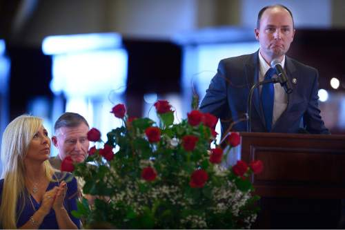 Scott Sommerdorf   |  The Salt Lake Tribune Lt. Governor Spencer Cox pauses to compose himself as he speaks during Utah's Salute to Law and Order held in the Hall of Governors at the State Capitol, Thursday, January 29, 2015. At left is Nannette Wride, wife of Utah County Sgt. Cory Wride.