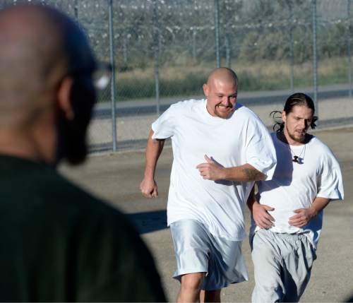 Al Hartmann  |  Tribune file photo One of the issues before the Legislature is how to curb the steep growth in inmate population and Utah's higher-than-average recidivism rate. Among proposals to address the subject are reduced charges and sentencing in drug-possession cases and more reliance on treatment. In this file photo, inmates in the Con-Quest substance abuse program run in the first 5K race at the Utah State Prison last August.