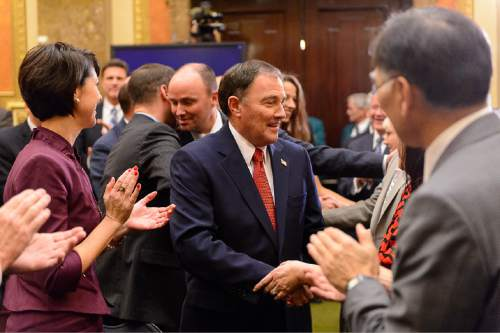 Trent Nelson  |  The Salt Lake Tribune Governor Gary Herbert enters the House Chamber to applause before delivering the state of the state address at the state capitol building in Salt Lake City, Wednesday January 28, 2015.