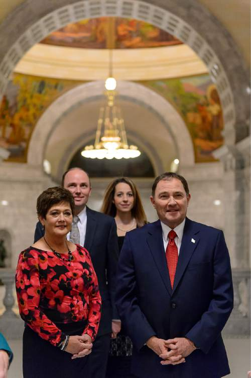 Trent Nelson  |  The Salt Lake Tribune Governor Gary Herbert, right, waits to enter the House Chamber to deliver the state of the state address at the state capitol building in Salt Lake City, Wednesday January 28, 2015. Left to right are Jeanette Herbert, Lieutenant Governor Spencer Cox, Abby Cox, Governor Gary Herbert.