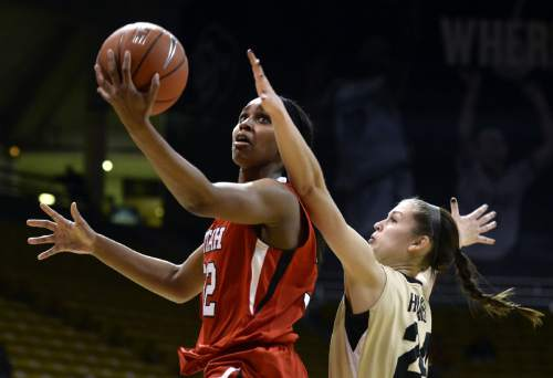Utah's Tanaeya Boclair goes for a layup in front of Colorado's Lauren Huggins during the first half of an NCAA college basketball game Wednesday, Jan. 14, 2015, in Boulder, Colo. (AP Photo/Daily Camera, Jeremy Papasso)