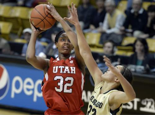 Utah's Tanaeya Boclair shoots against Colorado's Haley Smith during the first half of an NCAA college basketball game Wednesday, Jan. 14, 2015, in Boulder, Colo. (AP Photo/Daily Camera, Jeremy Papasso)