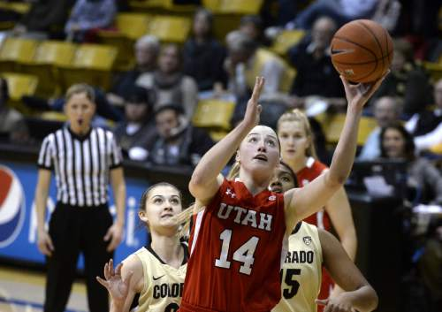 Utah's Paige Crozon drives to the basket past Colorado's Lauren Huggins, left, and Zoe Correal during the first half of an NCAA college basketball game Wednesday, Jan. 14, 2015, in Boulder, Colo. (AP Photo/Daily Camera, Jeremy Papasso)