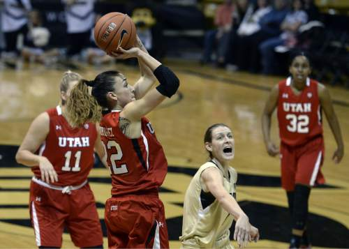 Utah's Danielle Rodriguez shoots over Colorado's Lexy Kresl during the first half of an NCAA college basketball game Wednesday, Jan. 14, 2015, in Boulder, Colo. (AP Photo/Daily Camera, Jeremy Papasso)