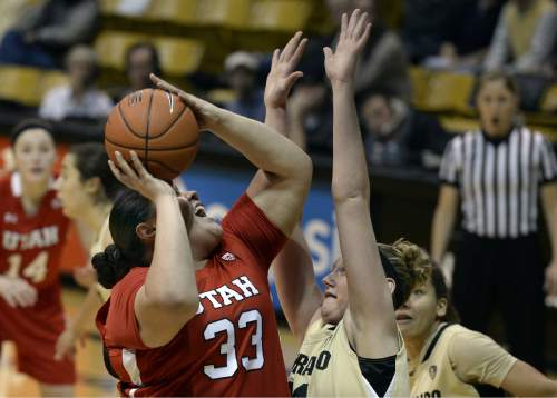 Utah's Joeseta Fatuesi shoots against Colorado's Jen Reese during the first half of an NCAA college basketball game Wednesday, Jan. 14, 2015, in Boulder, Colo. (AP Photo/Daily Camera, Jeremy Papasso)