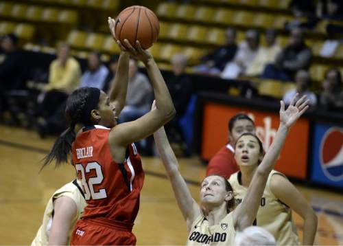 Utah's Tanaeya Boclair shoots over Colorado's Lexy Kresl during the first half of an NCAA college basketball game Wednesday, Jan. 14, 2015, in Boulder, Colo. (AP Photo/Daily Camera, Jeremy Papasso)